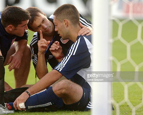 Clint Dempsey of the New England Revolution is asked How Many Fingers Do You See by the team trainer after he was involved in a collison in the...