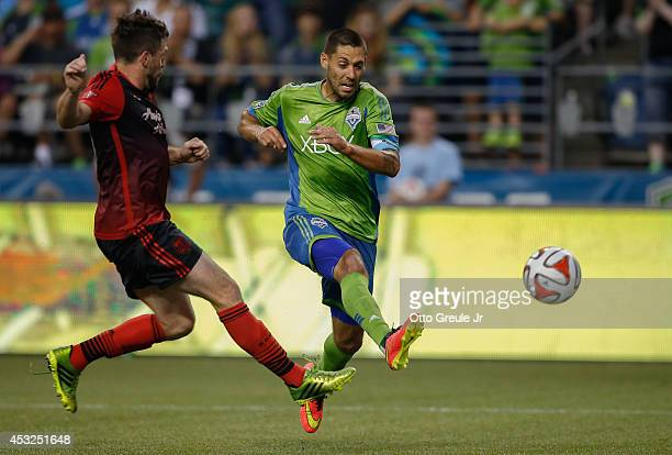 Clint Dempsey of the Seattle Sounders battles Danny O'Rourke of the Portland Timbers at CenturyLink Field on July 13 2014 in Seattle Washington