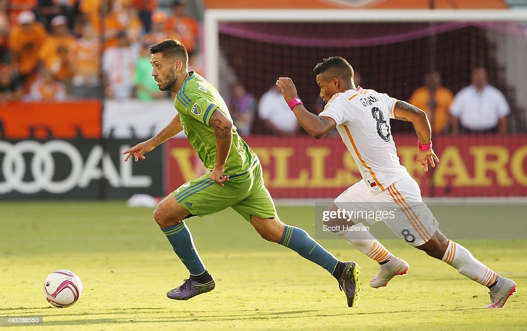 Clint Dempsey #2 of the Seattle Sounders FC and Luis Garrido #8 of the Houston Dynamo battle for the ball in the second half of their game at BBVA Compass Stadium on October 18, 2015 in Houston, Texas.