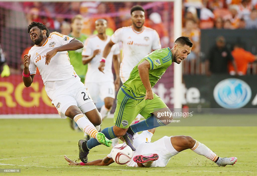 Clint Dempsey #2 of the Seattle Sounders FC and Sheanon Williams #22 of the Houston Dynamo battle for the ball in the second half of their game at BBVA Compass Stadium on October 18, 2015 in Houston, Texas.