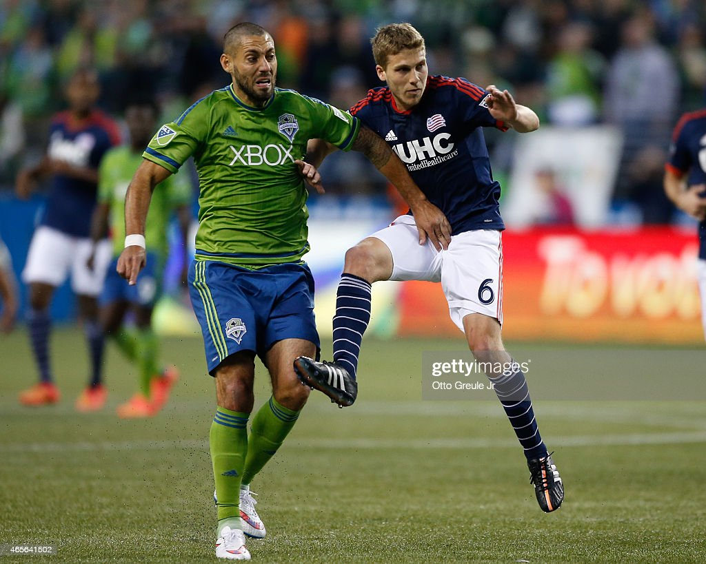 Clint Dempsey #2 of the Seattle Sounders FC battles Scott Caldwell #6 of the New England Revolution at CenturyLink Field on March 8, 2015 in Seattle, Washington. The Sounders defeated the Revolution 3-0.