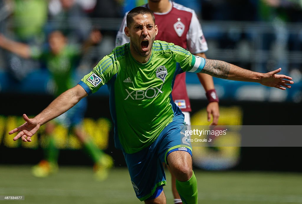 Clint Dempsey #2 of the Seattle Sounders FC reacts after scoring his second goal against the Colorado Rapids at CenturyLink Field on April 26, 2014 in Seattle, Washington. The Sounders defeated the Rapids 4-1.