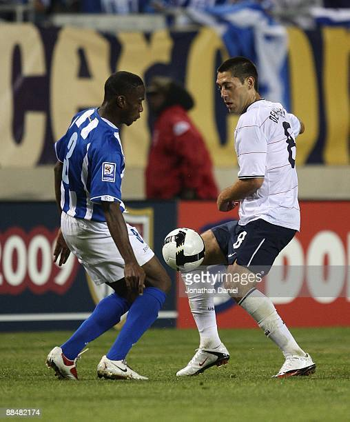 Clint Dempsey of the United States and Maynor Figueroa of Honduras battle for the ball during a FIFA 2010 World Cup Qualifying match on June 6 2009...