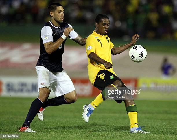 Clint Dempsey of the United States battles for the ball with Jason Morrison of Jamaica during the United States and Jamaica World Cup Qualifier at...