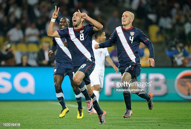 Clint Dempsey of the United States celebrates his goal with team mate Michael Bradley during the 2010 FIFA World Cup South Africa Group C match...