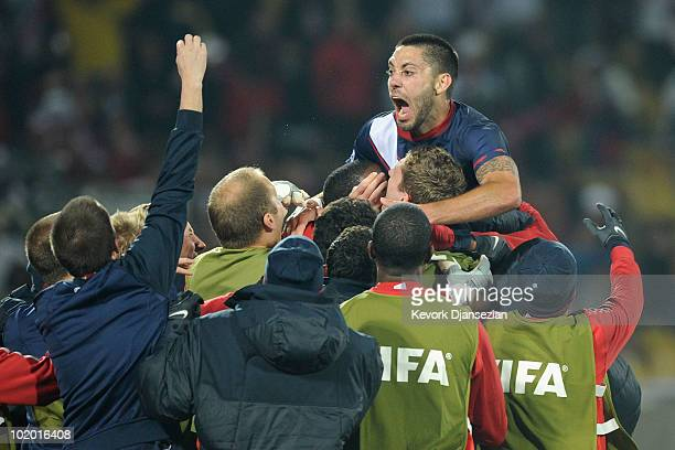 Clint Dempsey of the United States celebrates his goal with teammates during the 2010 FIFA World Cup South Africa Group C match between England and...