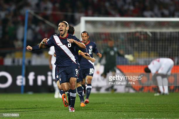 Clint Dempsey of the United States celebrates his team's first goal during the 2010 FIFA World Cup South Africa Group C match between England and USA...