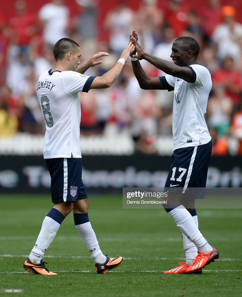 Clint Dempsey of the United States celebrates scoring his side's third goal with team mate Jozy Altidore during the International Friendly match between Germany and the United States at the RFK Stadium on June 2, 2013 in Washington, DC.