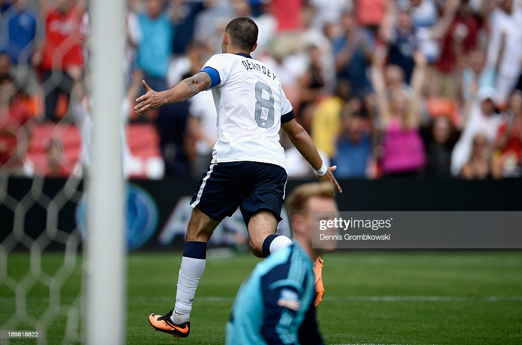 Clint Dempsey of the United States celebrates scoring his side's third goal during the International Friendly match between Germany and the United States at the RFK Stadium on June 2, 2013 in Washington, DC.