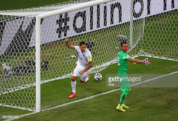 Clint Dempsey of the United States celebrates scoring his team's second goal past Beto of Portugal during the 2014 FIFA World Cup Brazil Group G...