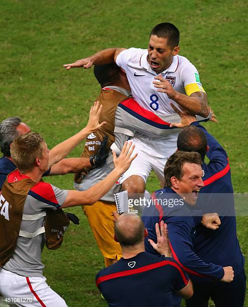 Clint Dempsey of the United States celebrates with teammates after scoring his team's second goal during the 2014 FIFA World Cup Brazil Group G match...