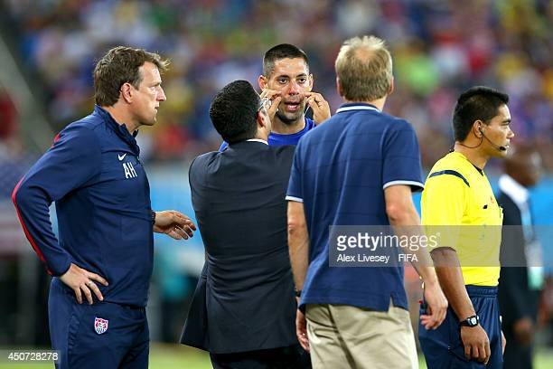 Clint Dempsey of the United States is treated for a nose injury during the 2014 FIFA World Cup Brazil Group G match between Ghana and USA at Estadio...