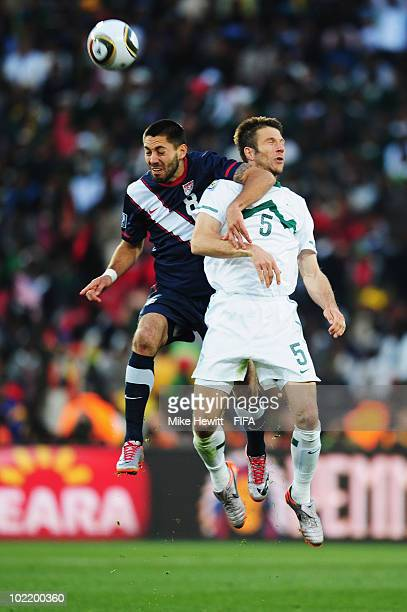 Clint Dempsey of the United States jumpf for a header with Bostjan Cesar of Slovenia during the 2010 FIFA World Cup South Africa Group C match...