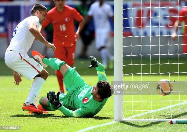 Clint Dempsey of the United States scores in the second half as Onur Recep Kivrak of Turkey is unable to stop the shot during an international...