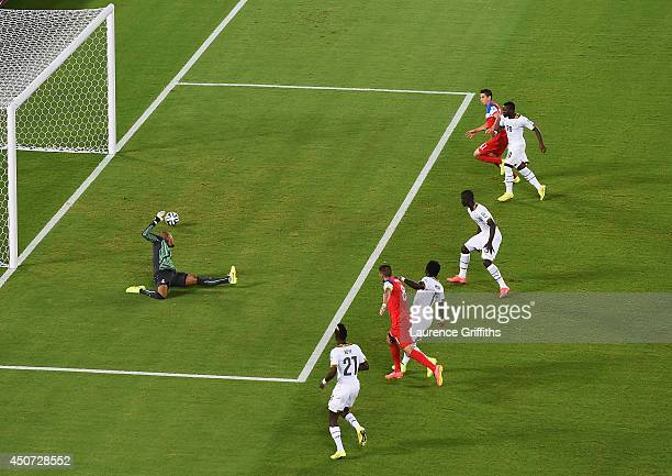 Clint Dempsey of the United States shoots and scores his team's first goal past goalkeeper Adam Kwarasey of Ghana during the 2014 FIFA World Cup...