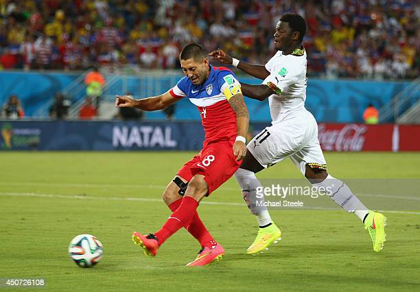 Clint Dempsey of the United States shoots and scores the team's first goal during the 2014 FIFA World Cup Brazil Group G match between Ghana and the...