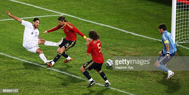 Clint Dempsey of the USA scores the 2:0 goal against Iker Casillas of Spain during the FIFA Confederations Cup Semi Final match between Spain and USA...
