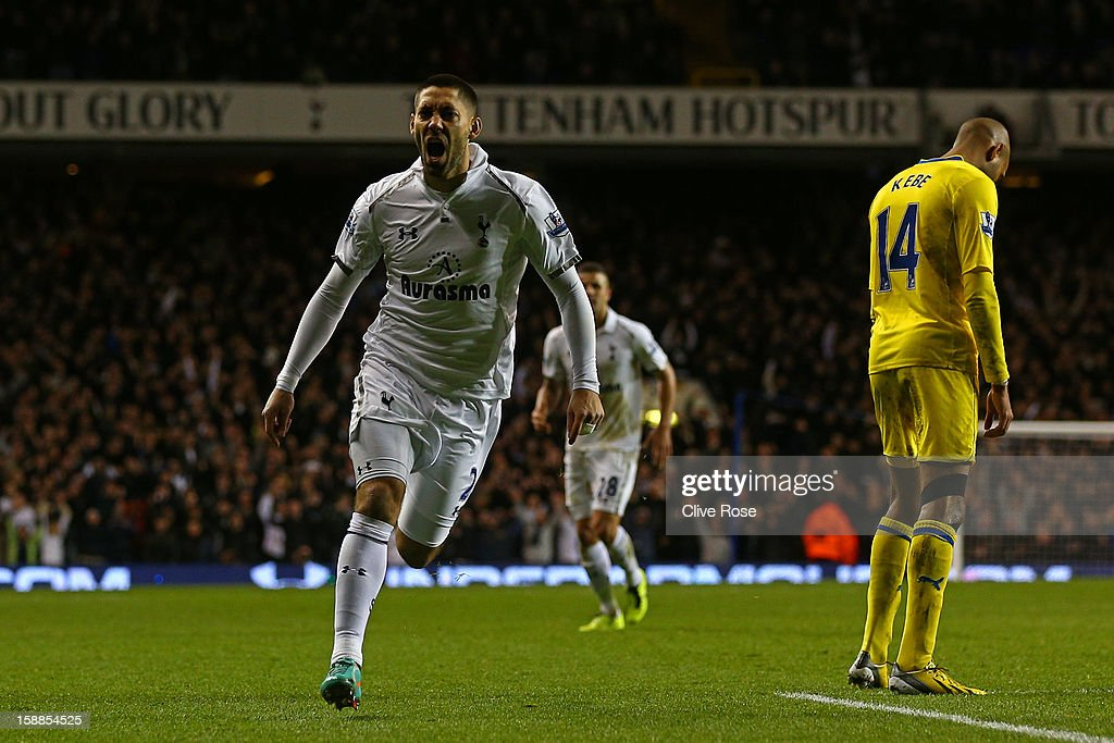 Clint Dempsey of Tottenham Hotspur celebrates scoring their third goal during the Barclays Premier League match between Tottenham Hotspur and Reading at White Hart Lane on January 1, 2013 in London, England.
