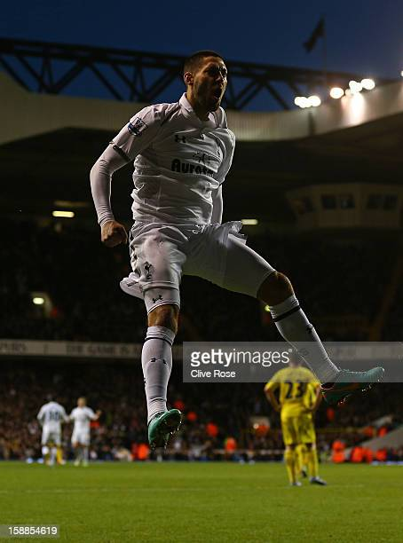 Clint Dempsey of Tottenham Hotspur celebrates scoring their third goal during the Barclays Premier League match between Tottenham Hotspur and Reading...