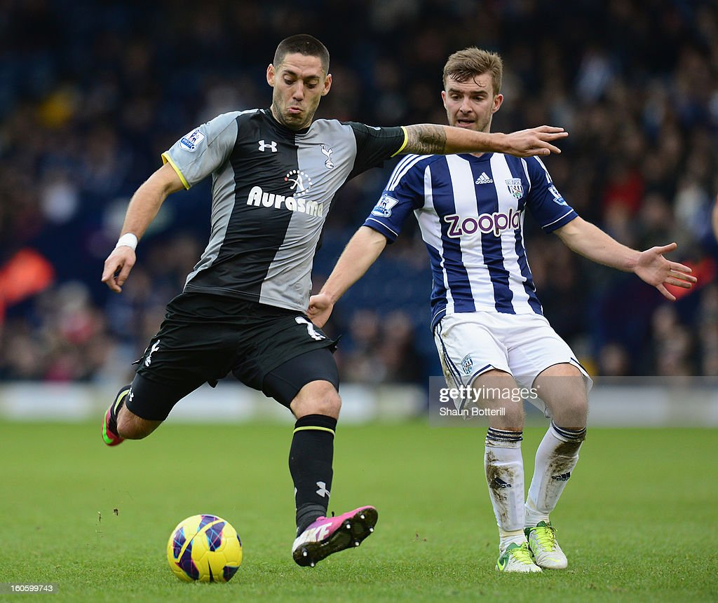 Clint Dempsey of Tottenham Hotspur is challenged by James Morrison of West Bromwich Albion during the Barclays Premier League match between West Bromwich Albion and Tottenham Hotspur at The Hawthorns on February 3, 2013 in West Bromwich, England.