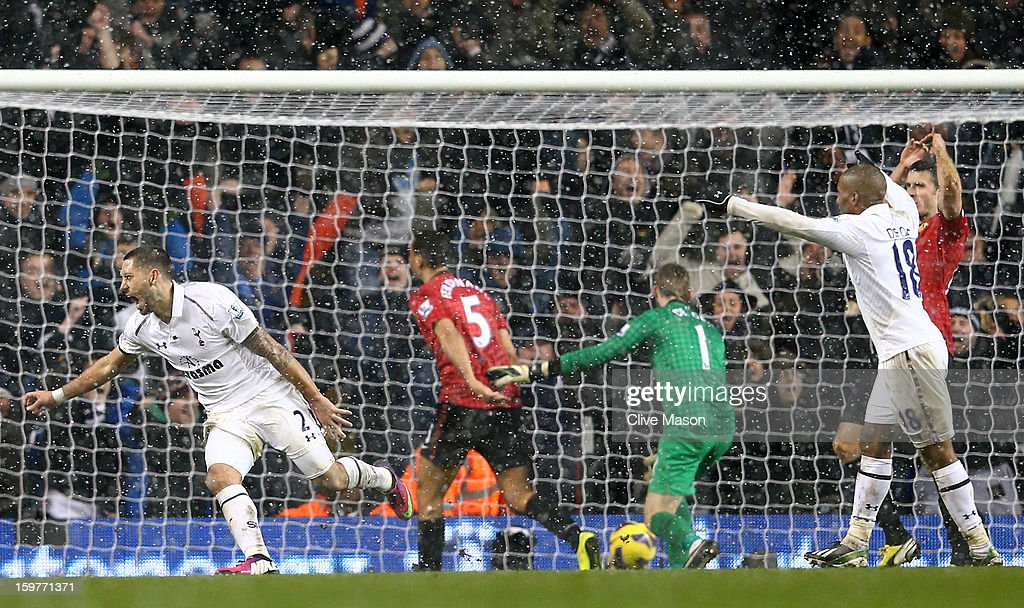 Clint Dempsey of Tottenham Hotspur turns to celebrate after scoring the equalising goal in stoppage time during the Barclays Premier League match between Tottenham Hotspur and Manchester United at White Hart Lane on January 20, 2013 in London, England.