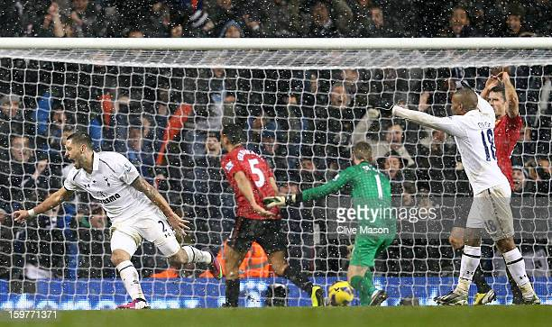 Clint Dempsey of Tottenham Hotspur turns to celebrate after scoring the equalising goal in stoppage time during the Barclays Premier League match...