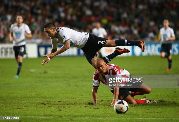 Clint Dempsey of Tottenhan Hotspur is tackled by Wes Brown of Sunderland during the Barclays Asia Trophy Semi Final match between Tottenham Hotspur...