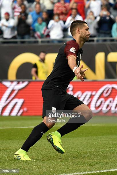Clint Dempsey of United States celebrates after scoring the opening goal through a penalty kick during a group A match between United States and...