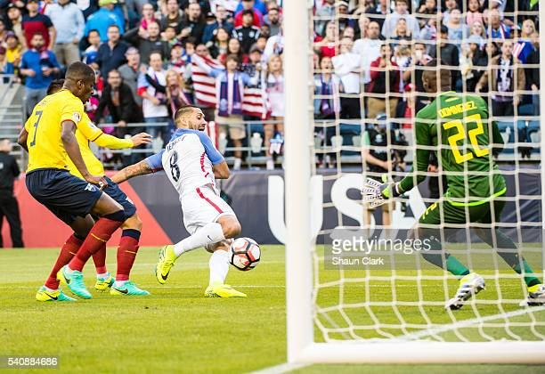 Clint Dempsey of United States crosses the ball for the second goal of the match as Alexander Dominguez of Ecuador defends during the Copa America...