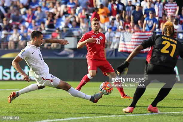 Clint Dempsey of United States of America scores a goal to make it 60 during the Gold Cup Quarter Final between USA and Cuba at MT Bank Stadium on...