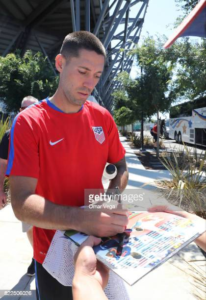 Clint Dempsey of United States signs autographs for the fans during the United States National Team training session prior to the final match against...