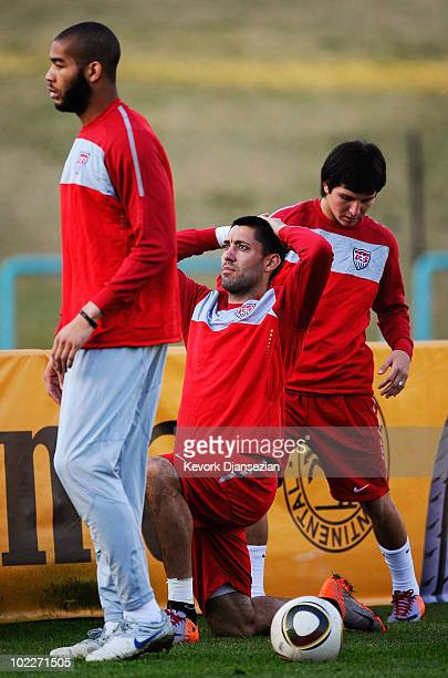 Clint Dempsey of US national football team warms up with teammates Oguchi Onyewu and Jose Torres during training session at Pilditch Stadium on June...