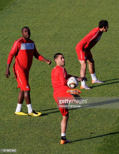 Clint Dempsey of USA national football team controls the ball as teammate Jozy Altidore looks on during training session at Pilditch Stadium on June...