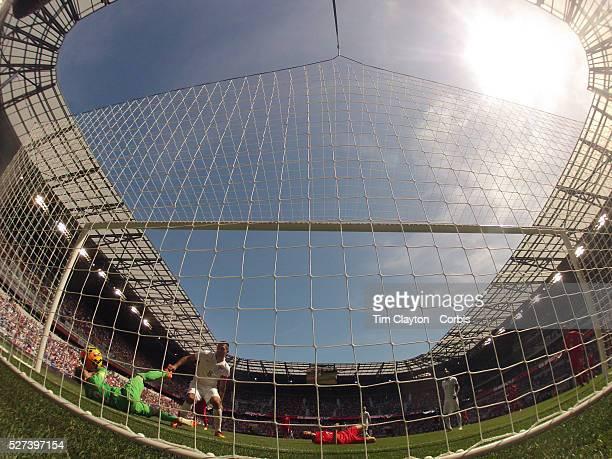 Clint Dempsey USA scores what proved to be the winning goal as he beats Goalkeeper Onur Recap Kivrak Turkey during the US Men's National Team's 21...