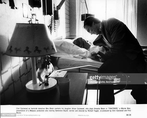 Clint Eastwood a homicide detective Wes Block comforts his daughter Alison Eastwood as Amanda Block in the hospital in a scene from the Warner Bros...
