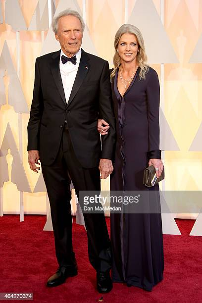 Clint Eastwood and Christina Sandera arrive at the 87th Annual Academy Awards at Hollywood & Highland Center on February 22, 2015 in Los Angeles,...