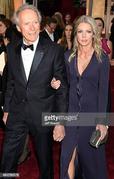 Clint Eastwood and Christina Sandera attend the 87th Annual Academy Awards at Hollywood & Highland Center on February 22, 2015 in Hollywood,...