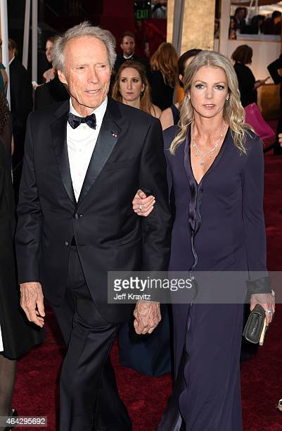 Clint Eastwood and Christina Sandera attend the 87th Annual Academy Awards at Hollywood Highland Center on February 22 2015 in Hollywood California