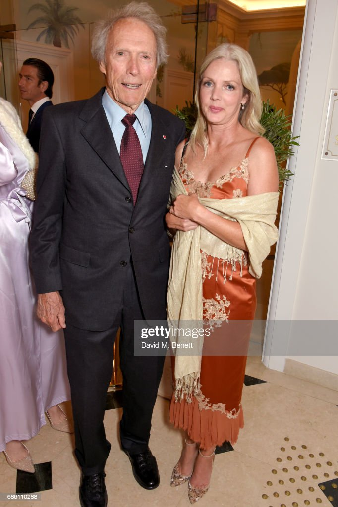 Clint Eastwood (L) and Christina Sandera attend the Vanity Fair and HBO Dinner celebrating the Cannes Film Festival at Hotel du Cap-Eden-Roc on May 20, 2017 in Cap d'Antibes, France.