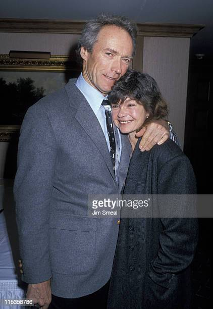 Clint Eastwood and Genevieve Bujold during 1989 LA Film Critics Awards at Bel Age Hotel in Hollywood California United States