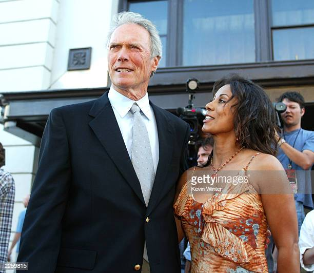 Clint Eastwood and Wanda De Jesus at the premiere of Blood Work at the Steven J Ross Theater on the Warner Bros Lot Burbank Ca Tuesday August 6 2002...