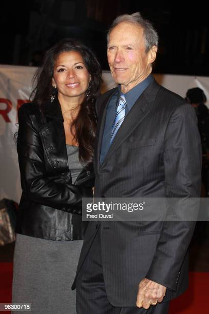 Clint Eastwood and wife Dina Ruiz attends the UK Film Premiere of 'Invictus' at Odeon West End on January 31 2010 in London England
