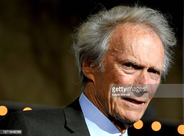 Clint Eastwood arrives at the premiere of Warner Bros Pictures' The Mule at the Village Theatre on December 10 2018 in Los Angeles California