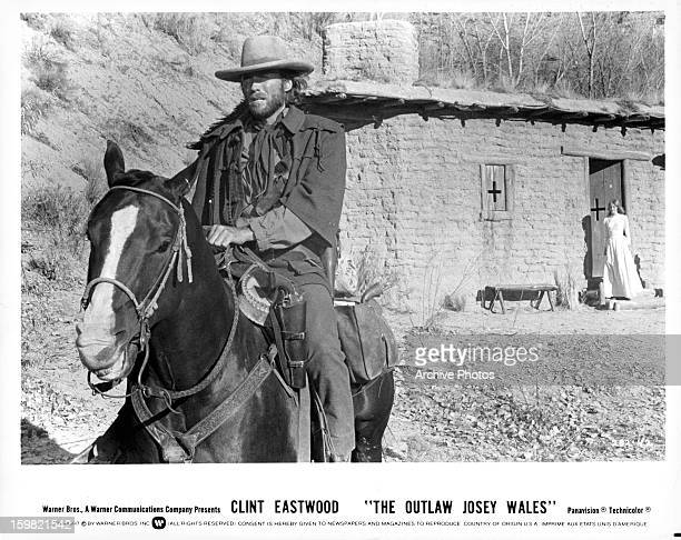 Clint Eastwood as Josey Wales riding off on horseback as Laura Lee looks on in a scene from Eastwood's 1976 western 'The Outlaw Josey Wales'