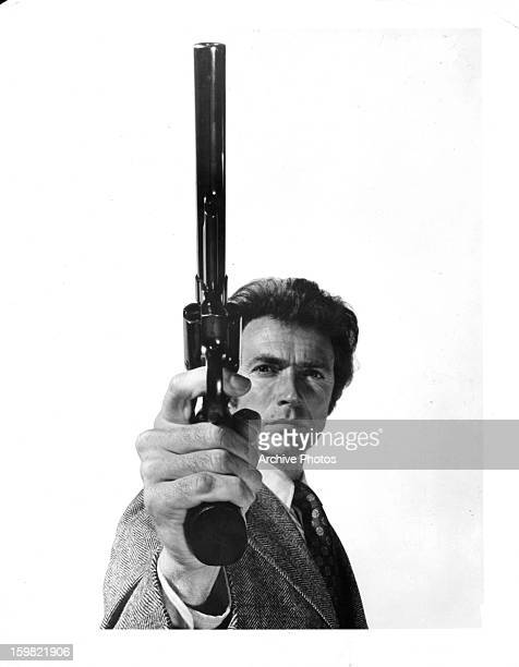 Clint Eastwood holds a gun in publicity portrait for the film 'Dirty Harry' 1971