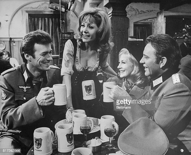 Clint Eastwood Ingrid Pitt Mary Ure and Richard Burton enjoy mugs of German Beer while filming Where Eagles Dare The film is a World War II adventure...