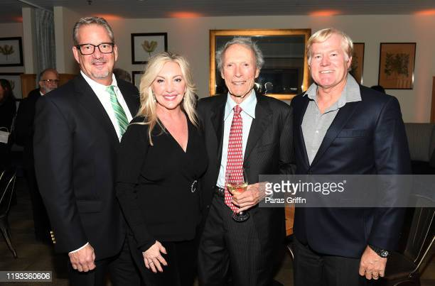 """Clint Eastwood poses with guests during """"Richard Jewell"""" After Party at White Oak Kitchen on December 10, 2019 in Atlanta, Georgia."""