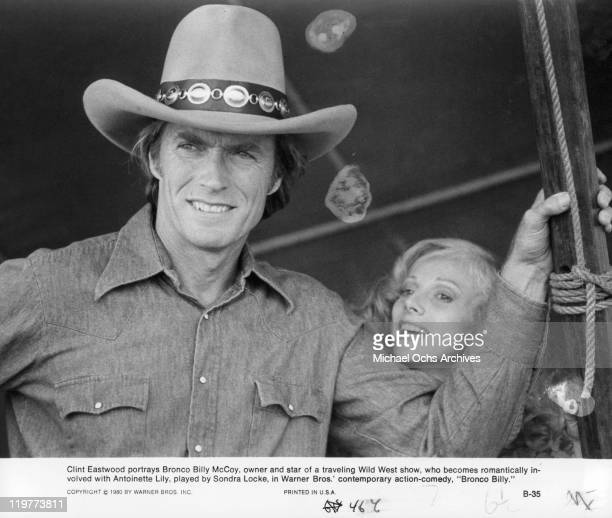Clint Eastwood smiling with Sandra Locke in a scene from the film 'Bronco Billy' 1980