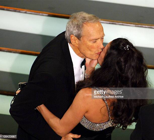 Clint Eastwood winner Best Director and Best Picture for Million Dollar Baby kisses Dina Eastwood