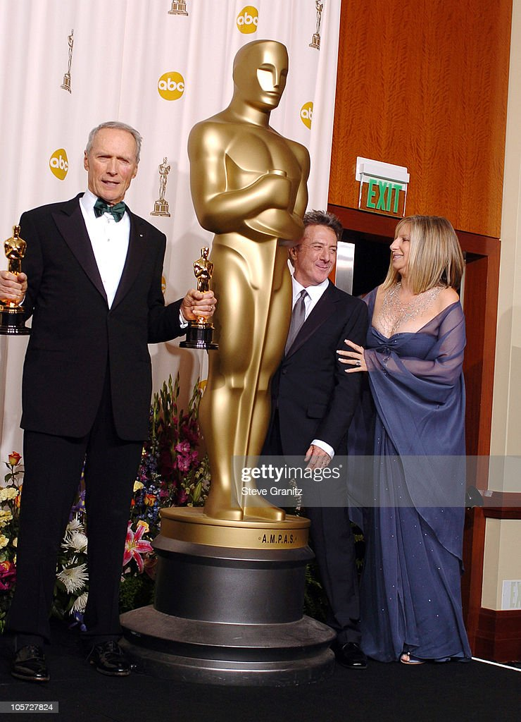 Clint Eastwood, winner Best Director for 'Million Dollar Baby' and Best Picture for 'Million Dollar Baby' with Dustin Hoffman and Barbra Streisand